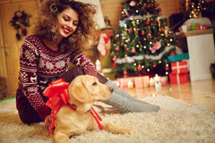 Girl with dog as Xmas gift at home Stock Photography