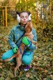 Girl and dog. Autumn Stock Photos
