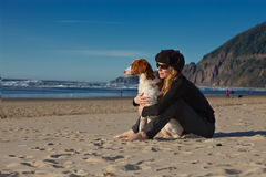 Girl & Dog on Beach Royalty Free Stock Image