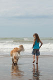 Girl with dog at the beach Royalty Free Stock Photography