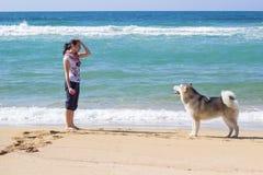 Girl dog beach Royalty Free Stock Image
