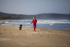 Girl with dog on beach Royalty Free Stock Photo
