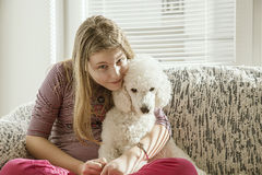 Girl with a dog on the bed Royalty Free Stock Image