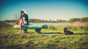 Girl and dog on the bench Royalty Free Stock Photography