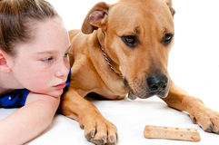 Girl, dog and bone Royalty Free Stock Photo