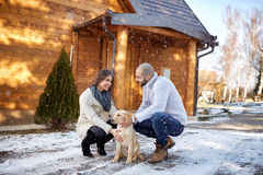 Girl with dog and boyfriend on winter holiday Stock Image