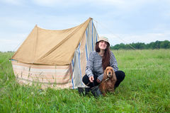 Girl with dog at camping Royalty Free Stock Images