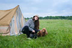 Girl with dog at camping. Young women with cocker spaniel at camping royalty free stock photos