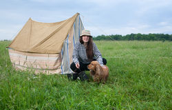 Girl with dog at camping Stock Photo
