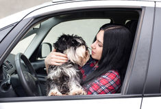Girl with dog in the car Stock Image