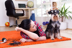 Girl and dog on the carpet Royalty Free Stock Images