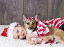 Girl and dog, christmas Royalty Free Stock Images