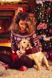 Girl with dog on Christmas evening Royalty Free Stock Photos