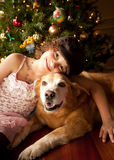 Girl and Dog with Christmas Tree royalty free stock photo