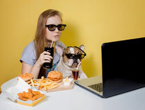 Girl and dog eating fast food Stock Photo