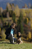 Girl and dog in field Royalty Free Stock Image