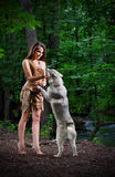 Girl with dog at forest Stock Images