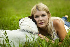 Girl with dog in grass Royalty Free Stock Photo