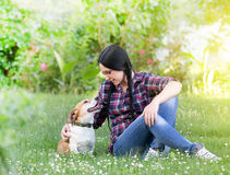 Girl with dog on grass Stock Photos