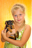 Girl with a dog Stock Photos