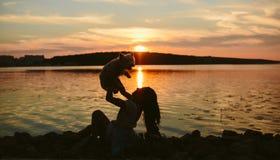 Girl and dog on the lake Stock Photography