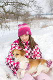 Girl with dog in lap Royalty Free Stock Images