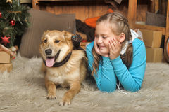 Girl and dog lie close Stock Photography