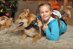 Girl and dog lie close Stock Image