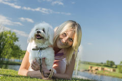 Girl and dog. Lying on the grass Stock Images
