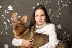 Girl with dog mongrel Stock Photo