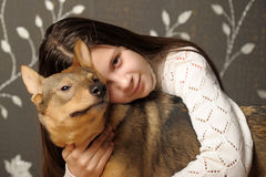 Girl with dog mongrel Royalty Free Stock Image