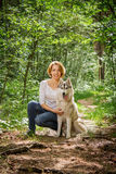 Girl with a dog in the nature royalty free stock images