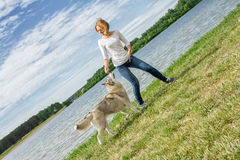 Girl with a dog in the nature royalty free stock photos