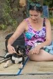 Girl and Dog. Nice girl and dog playing at riverside Royalty Free Stock Image