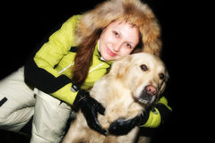 Girl with dog in night Stock Photography