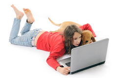 Girl and dog with notebook. Girl and dog looking in computer Royalty Free Stock Image