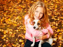 Happy girl with dog at autumn royalty free stock images