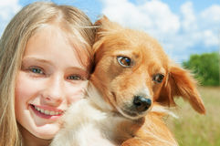 Girl and dog outdoors Stock Photo