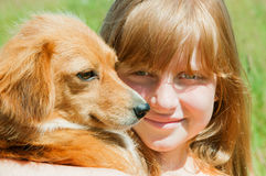 Girl and dog outdoors Royalty Free Stock Photo