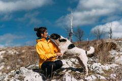 Girl with dog walking in the mountains stock photos