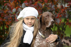 Girl with a dog in the park. Stock Photography