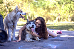 Girl with dog. In park Royalty Free Stock Image