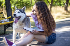 Girl with dog. In park Stock Images