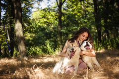Girl with dog. In park Royalty Free Stock Photo
