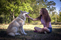 Girl with dog. In park Royalty Free Stock Images