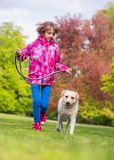 Girl with dog in park Royalty Free Stock Image