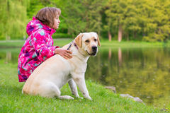 Girl with dog in park Royalty Free Stock Photo