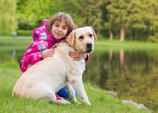 Girl with dog in park Stock Images