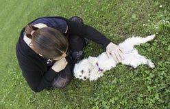 Girl in dog park Royalty Free Stock Photos