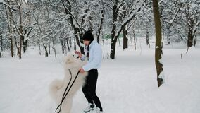 girl with dog in the park in winter
